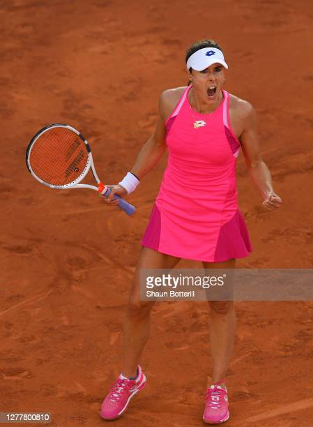 Alize Cornet of France celebrates after winning a point during her Women's Singles second round match against Shuai Zhang of China on day five of the...
