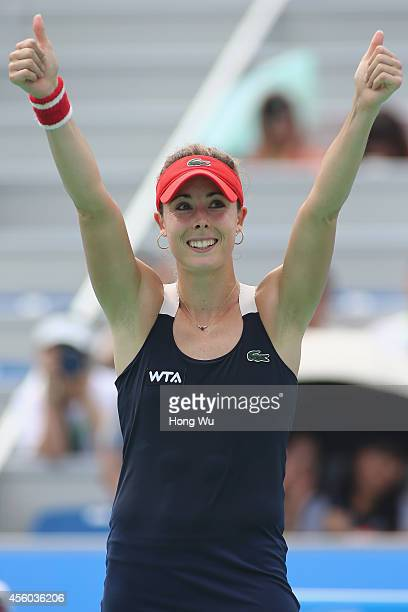 Alize Cornet of France celebrates after won her match against Kirsten Flipkens of Belgium during day four of the 2014 Dongfeng Motor Wuhan Open at...
