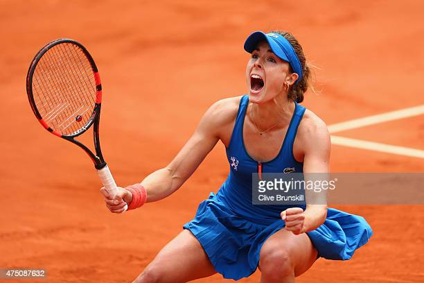 Alize Cornet of France celebrates match point in her Women's Singles match against Mirjana Lucic-Baroni of Croatia on day six of the 2015 French Open...