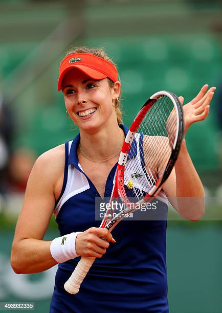Alize Cornet of France celebrates victory in her women's singles match against Ashleigh Barty of Australia on day two of the French Open at Roland...