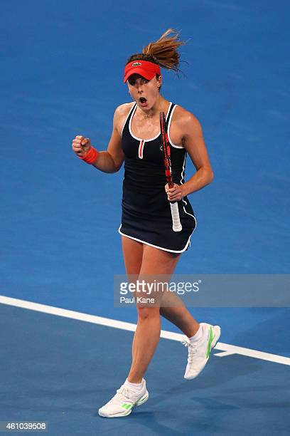 Alize Cornet of France celebrates winning her singles match against Heather Watson of Great Britain during day two of the 2015 Hopman Cup at Perth...