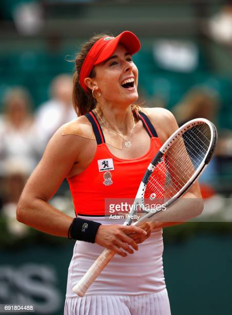 Alize Cornet of France celebrates winning her women's singles third round match against Agnieszka Radwanska of Poland during day seven of the French...