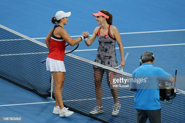 Alize Cornet of France congratulates Ash Barty of Australia after the women's singles match during day one of the 2019 Hopman Cup at RAC Arena on...