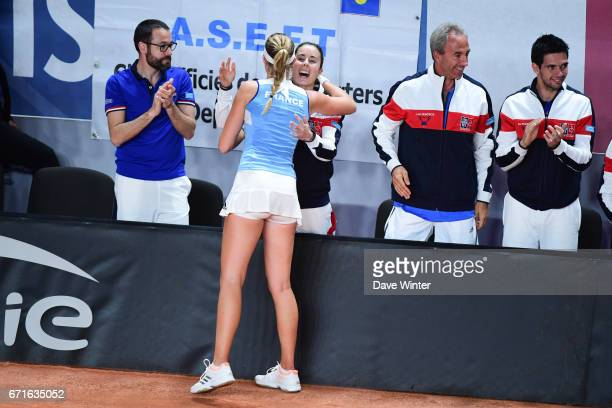 Alize Cornet of France congratulates Kristina Mladenovic of France after she wins the first rubber of the Fed Cup match between France and Spain on...