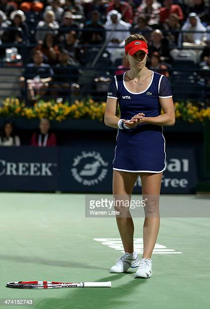 Alize Cornet of France drops her racket as she plays a return shot against Venus Williams of the USA during the final of the WTA Dubai Dury Free...