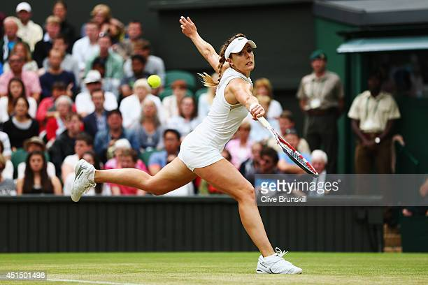 Alize Cornet of France during her Ladies' Singles fourth round match against Eugenie Bouchard of Canada on day seven of the Wimbledon Lawn Tennis...