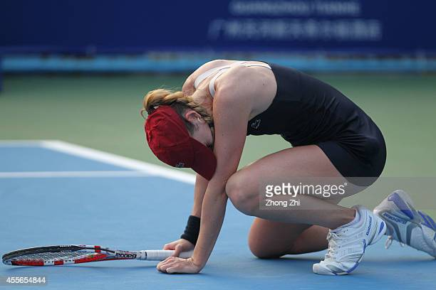 Alize Cornet of France falls down during her match against Hsieh Suwei of Chinese Taipei during day four of the 2014 WTA Guangzhou Open at Tianhe...