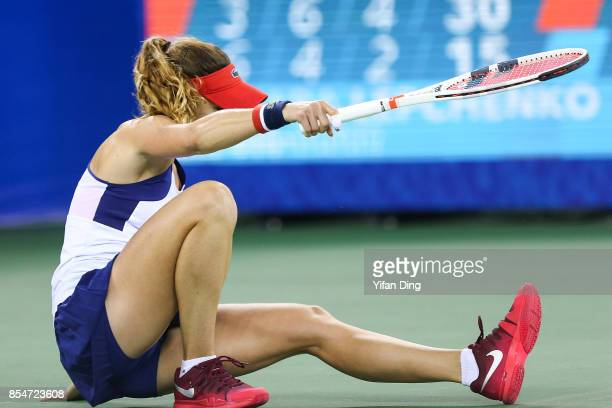 Alize Cornet of France falls down during the third round Ladies Singles match against Varvara Lepchenko of the United States on Day 4 of 2017...