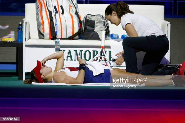 Alize Cornet of France gets injured during the women's singles tennis Quarterfinal match within the International Tennis Tournament VTB Kremlin Cup...