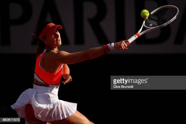 Alize Cornet of France hits a backhand during the ladies singles fourth round match against Caroline Garcia of France on day nine of the 2017 French...