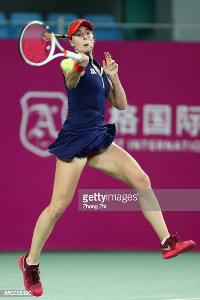 Alize Cornet of France hits a forehand during the match against Danka Kovinic of Montenegro on Day 3 of WTA Guangzhou Open on September 20 2017 in...