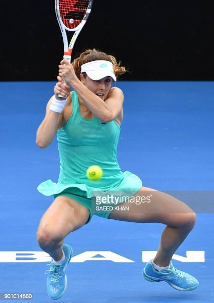 Alize Cornet of France hits a return against Aliaksandra Sasnovich of Belarus during their women's singles quarterfinal match at the Brisbane...