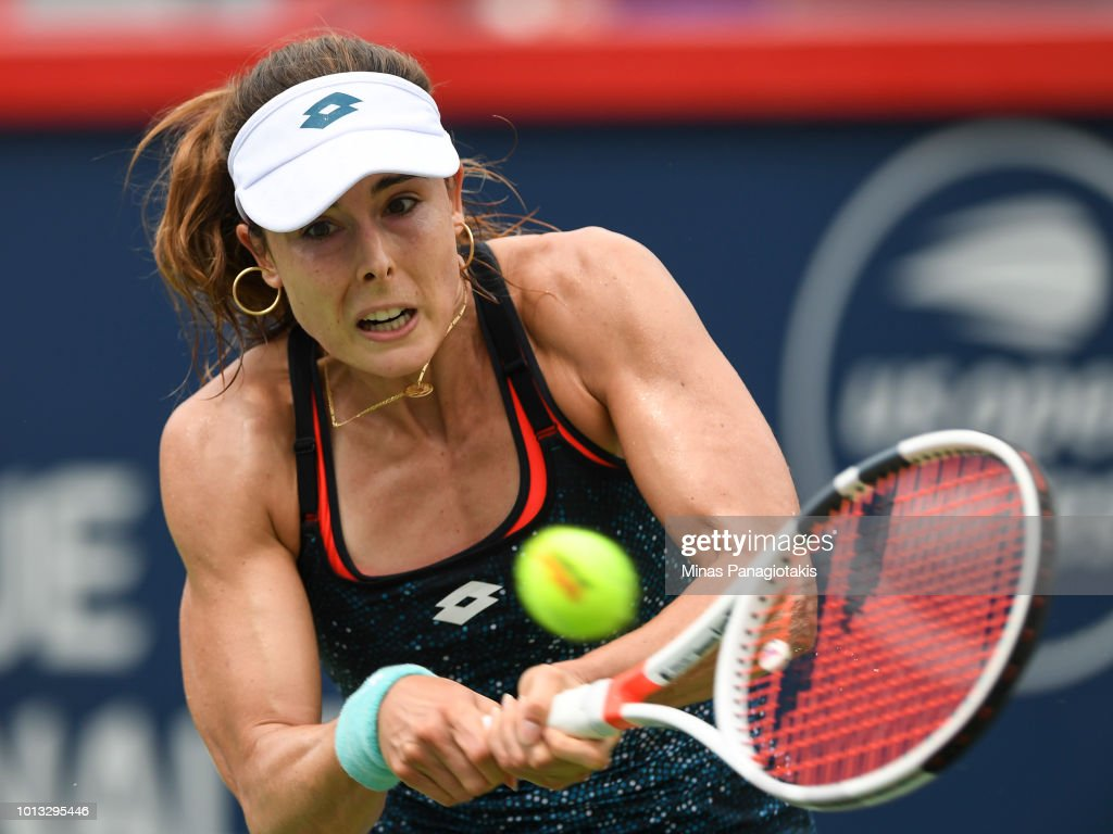 Alize Cornet of France hits a return against Angelique Kerber of Germany during day three of the Rogers Cup at IGA Stadium on August 8, 2018 in Montreal, Quebec, Canada.