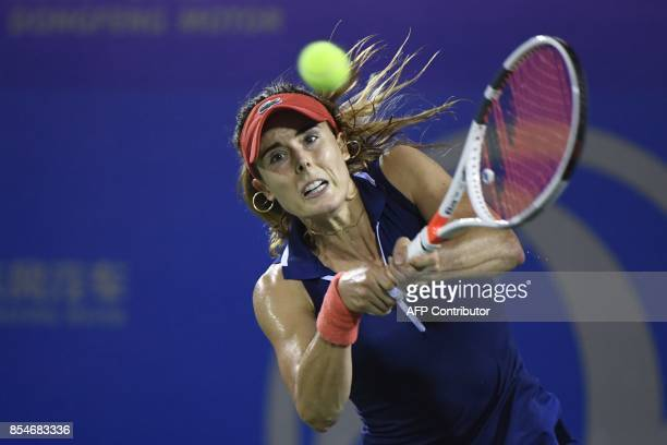 Alize Cornet of France hits a return against Varvara Lepchenko of the US during their third round women's singles match at the WTA Wuhan Open tennis...