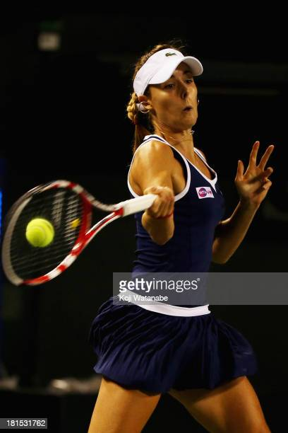 Alize Cornet of France in action during her women's singles first round match against Samantha Stosur of Australia during day one of the Toray Pan...