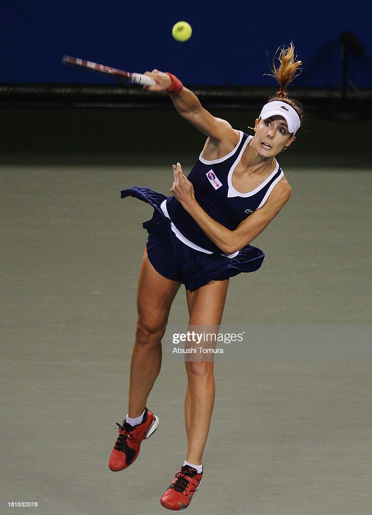 Alize Cornet of France in action during her women's singles first round match against Samantha Stosur of Australia during day one of the Toray Pan Pacific Open at Ariake Colosseum on September 22, 2013 in Tokyo, Japan.