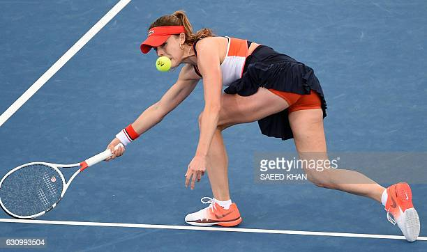 Alize Cornet of France lunges for a return against Dominika Cibulkova of Slovakia in their women's single quarterfinal match at the Brisbane...