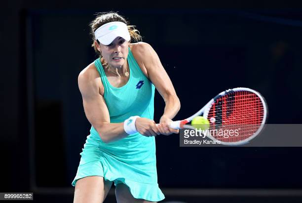 Alize Cornet of France plays a backhand in her match against Caroline Garcia of France during day one at the 2018 Brisbane International at Pat...