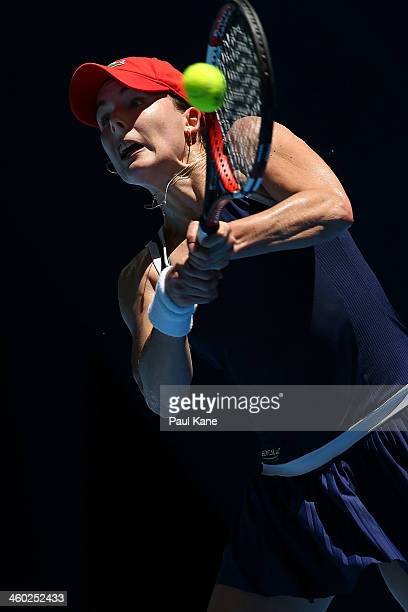 Alize Cornet of France plays a backhand to Anabel Medina Garrigues of Spain in the women's singles match during day seven of the Hopman Cup at Perth...