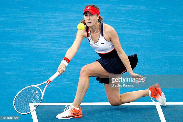 Alize Cornet of France plays a forehand against Garbine Muguruza of Spain on day six of the 2017 Brisbane International at Pat Rafter Arena on...