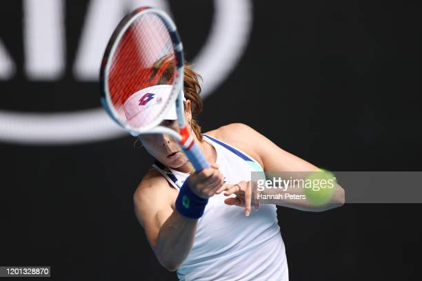 Alize Cornet of France plays a forehand during her Women's Singles second round match against Donna Vekic of Croatia on day four of the 2020...
