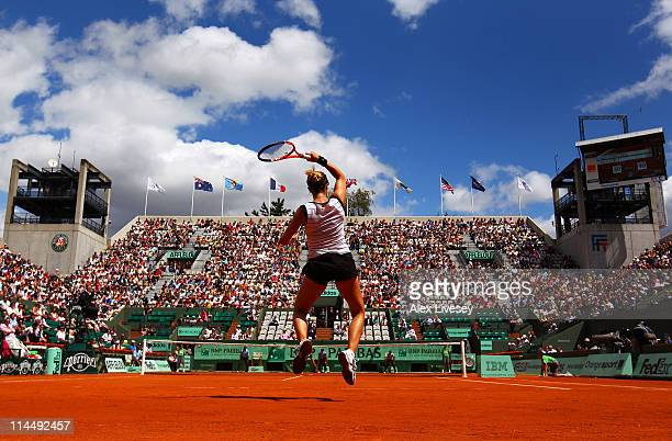Alize Cornet of France plays a forehand during the women's singles round one match between Renata Voracova of Czech Republic and Alize Cornet of...