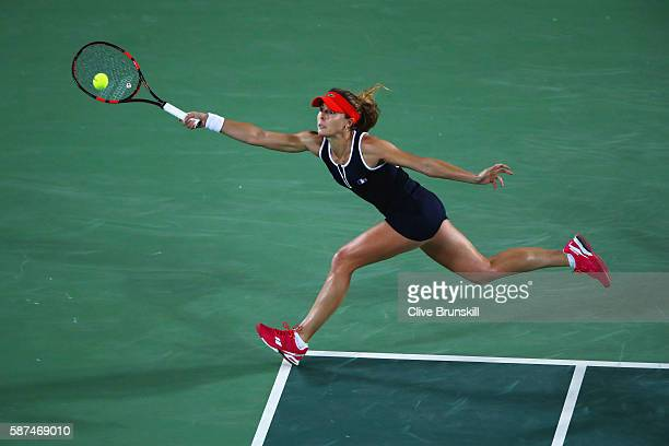 Alize Cornet of France plays a forehand during the Women's Singles second round match against Serena Williams of the United States on Day 3 of the...