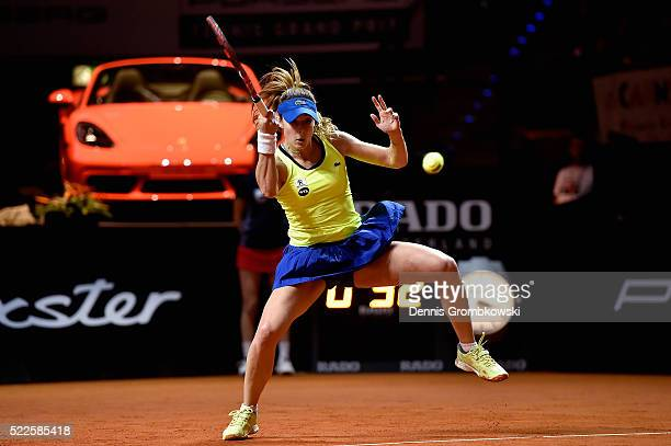 Alize Cornet of France plays a forehand in her match against Julia Goerges of Germany during Day 3 of the Porsche Tennis Grand Prix at PorscheArena...