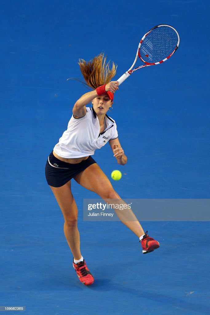 Alize Cornet of France plays a forehand in her second round match against Venus Williams of the United States during day three of the 2013 Australian Open at Melbourne Park on January 16, 2013 in Melbourne, Australia.
