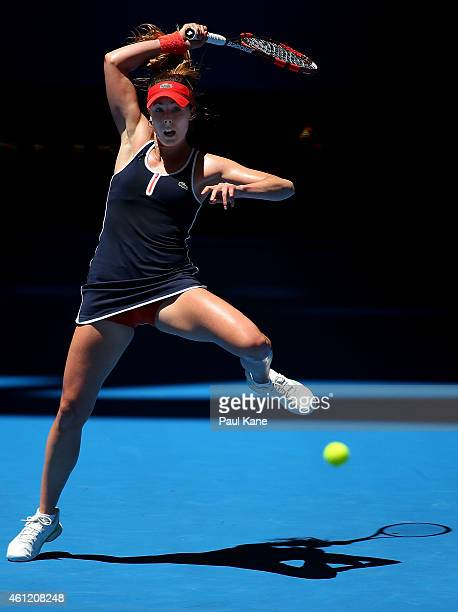 Alize Cornet of France plays a forehand in her singles match against Agnieszka Radwanska of Poland during day six of the 2015 Hopman Cup at Perth...