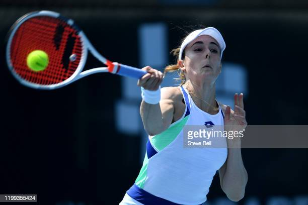 Alize Cornet of France plays a forehand shot during her first round match against Alison Van Uytvanck of Belgium during day four of the 2020 Hobart...