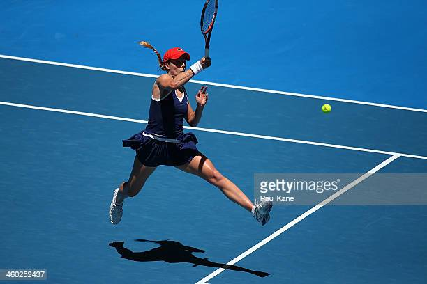 Alize Cornet of France plays a forehand to Anabel Medina Garrigues of Spain in the women's singles match during day seven of the Hopman Cup at Perth...