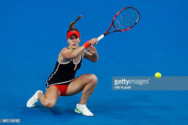Alize Cornet of France plays a forehand to Casey Dellacqua of Australia in the women's singles match during day four of the 2015 Hopman Cup at Perth...