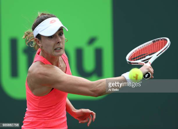 Alize Cornet of France plays a shot against Bethanie Mattek Sands during Day 3 of the Miami Open at the Crandon Park Tennis Center on March 19 2018...
