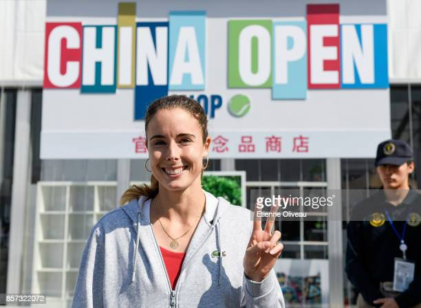 Alize Cornet of France poses for a picture at the merchandise booth on day five of the 2017 China Open at the China National Tennis Centre on October...