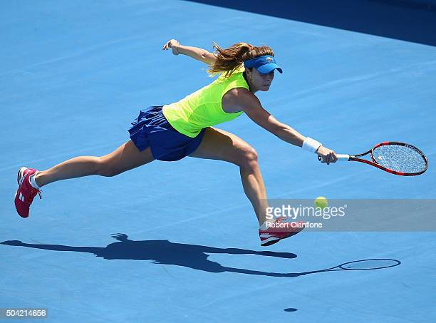 Alize Cornet of France reaches for the ball in the women's single match against Denisa Allertova of Czech Republic during day one of 2016 Hobart...