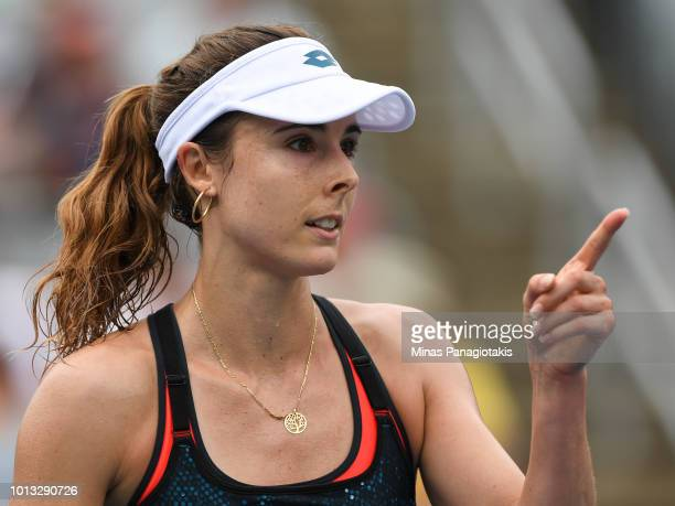 Alize Cornet of France reacts after bringing the game to match point against Angelique Kerber of Germany during day three of the Rogers Cup at IGA...