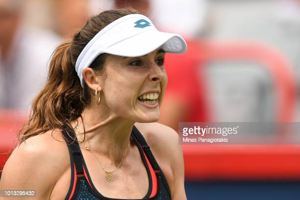 Alize Cornet of France reacts after losing a point against Angelique Kerber of Germany during day three of the Rogers Cup at IGA Stadium on August 8...