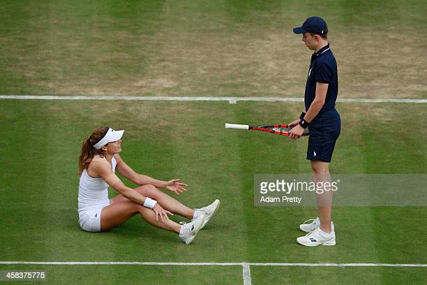 Alize Cornet of France reacts after slipping duiring the Ladies Singles third round match against Madison Keys of The United States on day six of the...