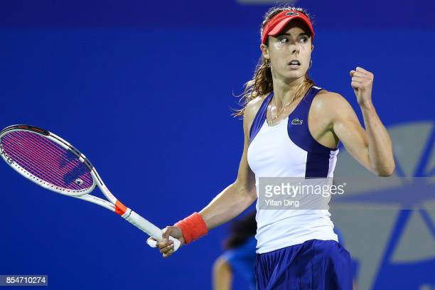 Alize Cornet of France reacts after winning a point during the third round Ladies Singles match against Varvara Lepchenko of the United States on Day...