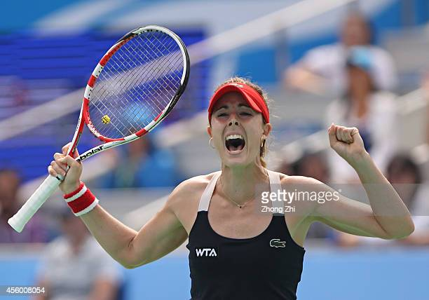 Alize Cornet of France reacts after winning her match against Kirsten Flipkens of Belgium on day four of 2014 Dongfeng Motor Wuhan Open at Optics...