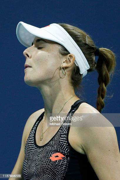 Alize Cornet of France reacts during her match against Mihaela Buzarnescu of Romania during Day 5 of the Miami Open Presented by Itau at Hard Rock...