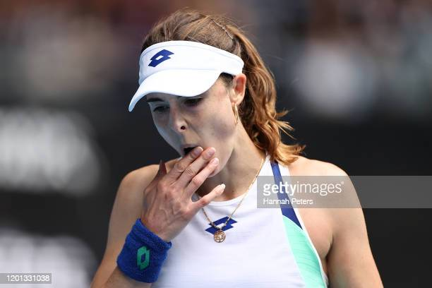 Alize Cornet of France reacts during her Women's Singles second round match against Donna Vekic of Croatia on day four of the 2020 Australian Open at...
