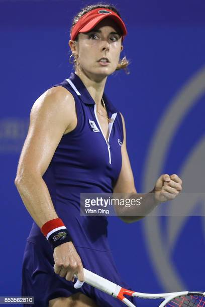 Alize Cornet of France reacts during the match against Anastasia Pavlyuchenkova of Russia on Day 2 of 2017 Dongfeng Motor Wuhan Open at Optics Valley...
