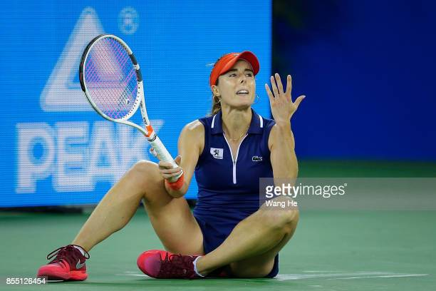 Alize Cornet of France reacts during the match against Maria Sakkari of Greece on Day 5 of 2017 Dongfeng Motor Wuhan Open at Optics Valley...