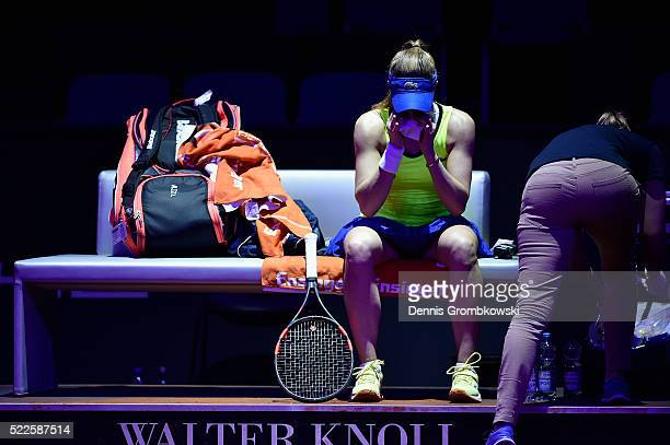 Alize Cornet of France receives medical treatment during her match against Julia Goerges of Germany during Day 3 of the Porsche Tennis Grand Prix at...