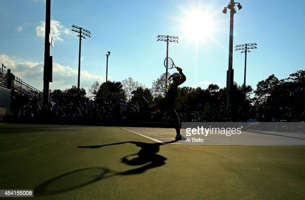 Alize Cornet of France returns a shot against Amandine Hesse of France during her women's singles first round match on Day One of the 2014 US Open at...