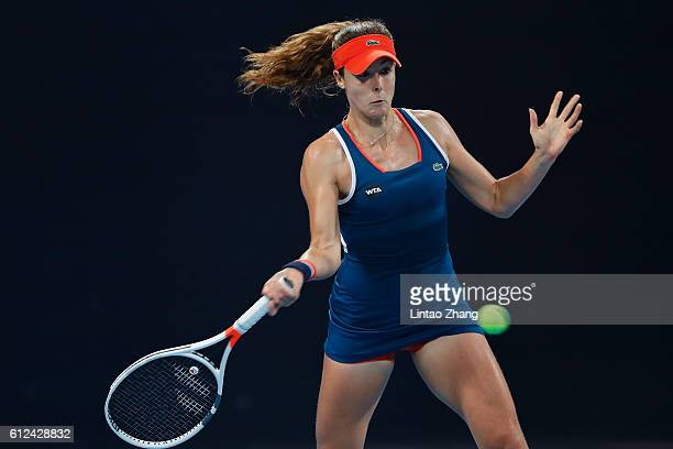 Alize Cornet of France returns a shot against Dominika Cibulkova of Slovakia during the Women's singles second round match on day four of the 2016...
