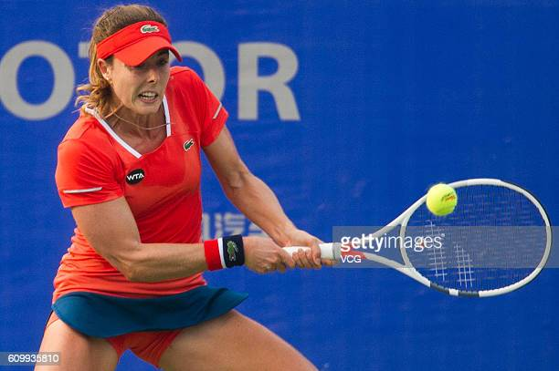 Alize Cornet of France returns a shot against Jennifer Brady of the United States during the qualifying match of 2016 WTA Dongfeng Motor Wuhan Open...