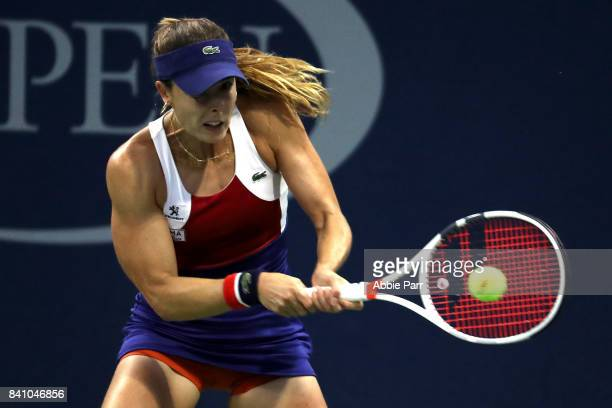 Alize Cornet of France returns a shot against Petra Kvitova of Czech Republic during their second round Women's Singles match on Day Three of the...